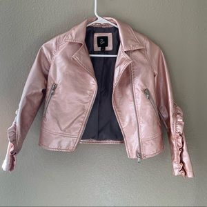 Pink pleather jacket with zipper and ruffle detail